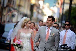 married couple walking toward reception