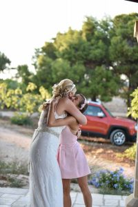 Bride hugging the sister